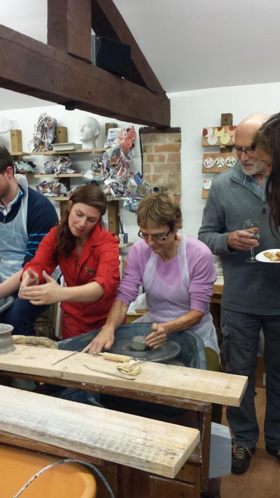 Me teaching pottery